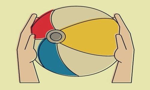 Image représentant la métaphore du ballon sur la plage